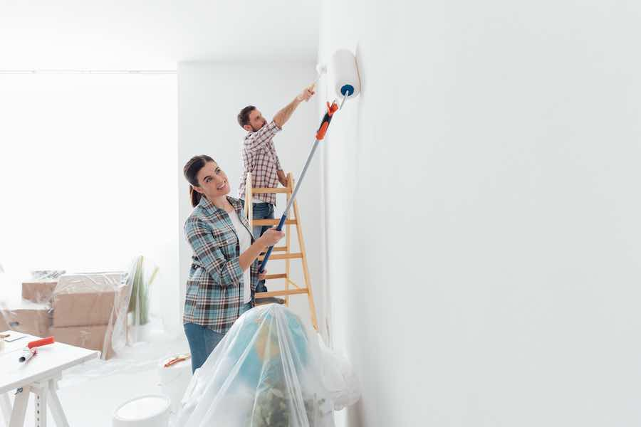 couple painting walls white
